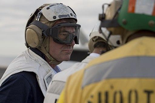 Ash Carter and Manohar Parrikar observe flight operations as they tour the USS Dwight D. Eisenhower