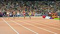 Athletes on the track in the Mens 400m T44 competition (9375719735).jpg