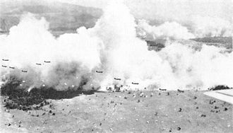 503rd Infantry Regiment (United States) - Dwarfed by and silhouetted against clouds of smoke (created to provide concealment), C-47s from the USAAF drop a battalion of the 503rd at Nadzab, New Guinea. A battalion dropped moments earlier is landing in the foreground.