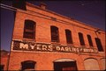 BUILDING IN THE DOWNTOWN AREA OF AN OLD MINING TOWN - NARA - 544077.tif