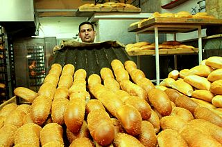 Bakery establishment that produces and sells flour-based food baked in an oven