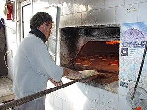 Barbari bread - Baker baking Barbari bread in a traditional oven