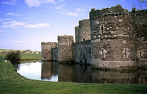 Beaumaris Castle - The moated north-west walls of the outer ward
