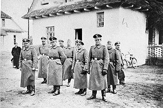 Bełżec extermination camp - Belzec extermination camp SS staff, 1942. Right to left: Heinrich Barbl, Artur Dachsel, Lorenz Hackenholt, Ernst Zierke, Karl Gringers. Left (uniformed): Friedrich Tauscher, Karl Alfred Schluch (second).