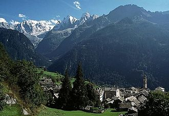 Bregaglia Range - View across the village of Soglio (foreground) to the peaks of the western Bregaglia – the Sciora peaks (left), Piz Cengalo (left centre) and Piz Badile (centre)