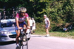2005 Giro d'Italia - Paolo Bettini wearing the purple jersey as leader of  points classification while climbing the Colle di Tenda during stage 17.