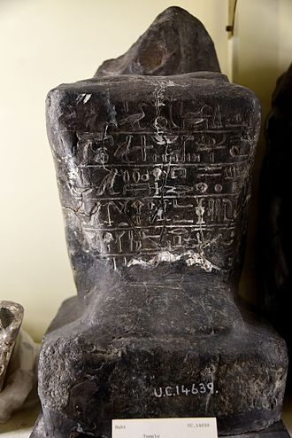 Naqada - Black granite, seated statue of Sennefer with cartouche of Amenhotep (Amenophis) II on right arm. From the temple of Seth at Naqqada, Egypt. The Petrie Museum of Egyptian Archaeology, London