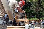 Bond beam work at Gabriela Mistral School construction site 150622-F-LP903-632.jpg