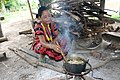 Brao woman cooking over a wood stove.JPG