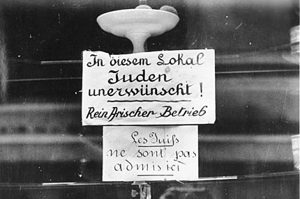 a german sign outside a paris restaurant announces that jews are not admitted bundesarchiv 1 september 1940