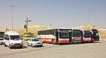 Buses and vans in parking lot on West Bank side of Hussein-Allenby Bridge.jpg