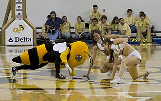 Twister (game) - Buzz and Georgia Tech Yellow Jacket cheerleaders playing Twister using the floor of Alexander Memorial Coliseum