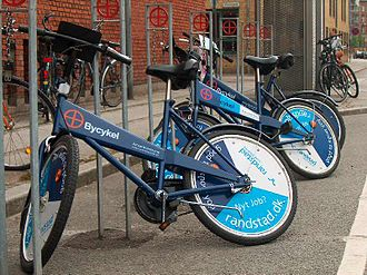 Bicycle-sharing system - Three Bycykel returned at a coin deposit station Aarhus City Bikes