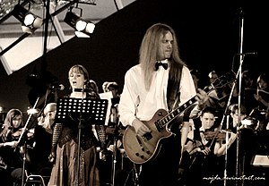Symphonic metal - Therion's Lori Lewis and Christofer Johnsson with symphonic orchestra and choir during the live classical show at the Miskolc Opera Festival, Hungary, 2007.