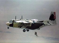 Photograph showing a CASA C-212 of the Chilean Air Force, with a parachutist jumping from the rear of the aircraft