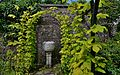 CRATHES CASTLE GARDEN Vine arch framing a garden sculpture.JPG