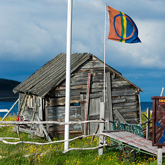 Sami flag - The Sami flag flying outside a cabin