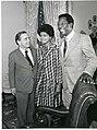 Carl Albert posing with Hank Aaron and his wife.jpg