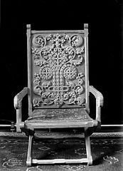 Chair with ornately carved decoration