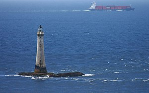 Chicken Rock Lighthouse - Chicken Rock lighthouse with passing cargo vessel