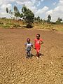 Chidren standing on once a dam.jpg