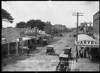 Opotiki - Opotiki's Church Street, ca. 1920s.