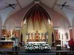 Church of the Sacred Heart (Coshocton, Ohio) - nave with Easter decoration.JPG