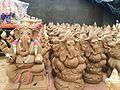 Clay images of God Ganesh on display at a Ganesh Chaturthi shop.jpg