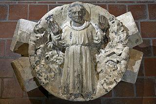 Clef de voûte ornée de Saint François d'Assise