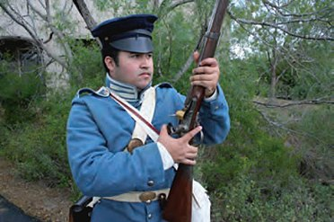 Cocking a Mexican War era flintlock.jpg