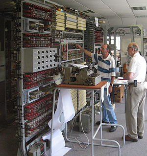 Colossus computer - A team led by Tony Sale (right) reconstructed a Colossus Mark II at Bletchley Park. Here, in 2006, Sale supervises the breaking of an enciphered message with the completed machine.