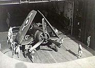 Corsair being pushed on elevator HMS Glory (R62) 1945
