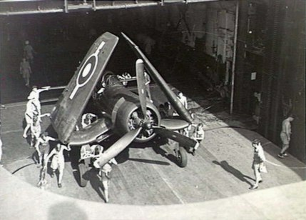 Corsair being pushed on elevator HMS Glory (R62) 1945