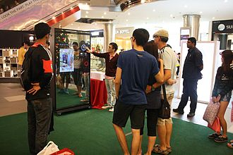 Photo booth - An open-plan photo booth with gesture recognition and touch-screen interface in Lot 10 Shopping Centre in Kuala Lumpur, Malaysia