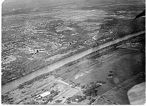 Rich Field -  U.S. Army Air Corps Flyers from Rich Field over the Brazos River in Waco, 1918. It shows a formation of aircraft over the Brazos River and is one of the first aerial photos of Waco.