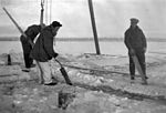 Cutting ice to lift airplane out of water (14124473006).jpg