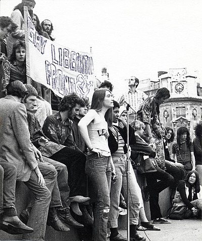 A Gay Liberation march in London, UK, ca. 1972. A Gay Liberation Front banner is visible. Location is believed to be Trafalgar Square.[71][full citation needed]