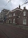 foto van Voormalige diaconale bakkerij annex woonhuis voor de bakker en bergplaats voor granen in eclectische bouwstijl