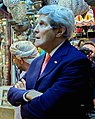 Detail, Secretary Kerry Examines Khanjar Knives During Visit to Muttrah Souk in Oman (cropped).jpg
