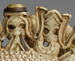 Benin ivory mask - Detail of Portuguese merchant head and mudfish