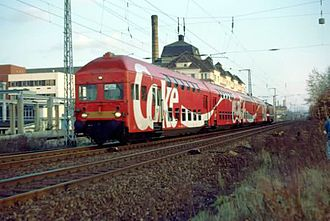 Pirna–Coswig railway - An S-Bahn service at Dresden-Dobritz in 1991, the trackless and overgrown land immediately to the right of the track was occupied by long-distance tracks until 1946