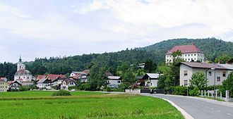 Dobrova, Dobrova–Polhov Gradec - Dobrova with the parish church (left), the rectory and convent (top right), and Dobrova Hill in the background