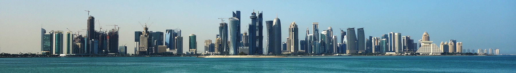 The Doha city skyline, featuring post-modern structures along the Corniche.