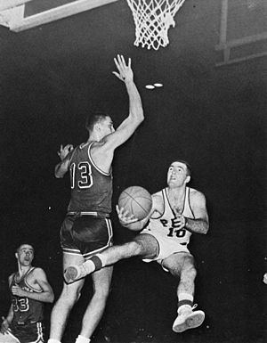 Pittsburgh Panthers men's basketball - Pitt All-American Don Hennon drives around Duquesne University's Bob Slobodnik during a 71–56 Pitt victory in the Steel Bowl tournament on December 13, 1958