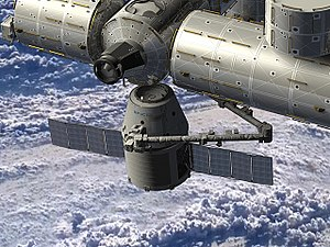 SpaceX CRS-13 - Artist rendering of the SpaceX Dragon spacecraft being berthed to ISS