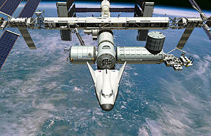 Dream Chaser - Artist's conception of the Dream Chaser Cargo System Docked to ISS