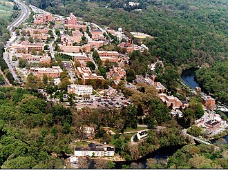 DuPont Experimental Station - Aerial photo of the Dupont Experimental Station in the summer of 1997. The Brandywine Creek is in the immediate foreground and right. The stone building in the center of the picture is the original clubhouse of the Dupont Country Club which has now been displaced to the upper left of the photo. The Nemours Mansion and Gardens is seen in the upper center. Hagley Museum is off the picture to the immediate left. The highway in the upper left is Delaware Route 141, and all of this is part of the DuPont Historic Corridor.
