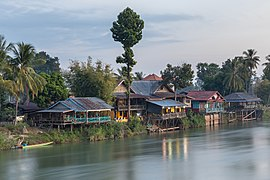 Dwellings on the Mekong bank of Don Det at sunrise seen from the bridge to Don Khon Laos.jpg