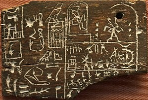 "Den (pharaoh) - Ebony label EA 32650 from Den's tomb. The upper right register depicts king Den twice: at the left he is sitting in his Hebsed pavilion, at the right he is running a symbolic race around D-shaped markings. This ceremony is connected to the so-called ""race of the Apis bull"". The middle right section reports about the raid of the city ""beautiful door"" and about a daughter of Den suffering from an unknown disease. The lower right section reports about the visitation of the ""souls of Peh"" at the royal domain ""Wenet"". The left part of the label describes the content of the vessel that once belonged to the label and mentions the high official Hemaka, who was obviously responsible for the delivery of the labeled jar."