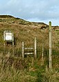 Empty information board and stile near Todmorden (6338233540).jpg
